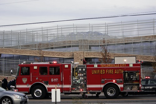 Kim Raff  |  The Salt Lake Tribune Fire and police officers respond to the scene of teen's suicide on the pedestrian bridge near Bennion Junior High School in Taylorsville on Nov. 29, 2012.