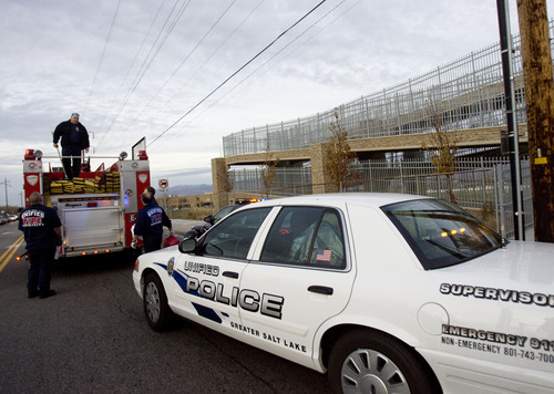 Kim Raff  |  The Salt Lake Tribune Firefighters and police officers respond to the scene of teen's suicide on the pedestrian bridge near Bennion Junior High School in Taylorsville on Nov. 29, 2012.