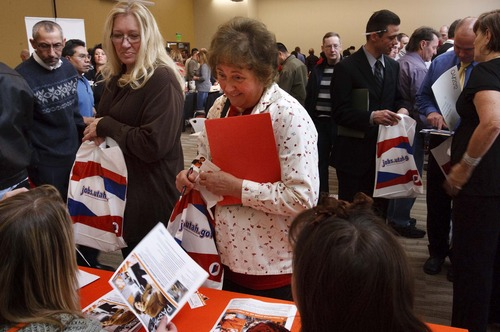 Leah Hogsten  |  The Salt Lake Tribune Former Hostess Bakery workers Jan Dowler (left) and Linda Larkin talk to Home Depot representatives about working for their company.  The Utah Department of Workforce Services and the Ogden/Weber Technology hosted a job fair for hundreds of former Hostess Employees on Thursday November 29, 2012 in Ogden.