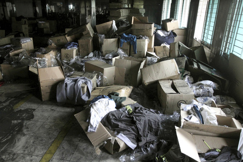 FILE -In this Wednesday, Nov. 28, 2012, file photo, boxes of garments lay near equipment charred in the fire that killed 112 workers Saturday at the Tazreen Fashions Ltd. factory,on the outskirts of Dhaha, Bangladesh. The horrific fire that killed 112 people, Saturday, Nov. 24, 2012, has put the spotlight back on those factory workers and their sometimes treacherous work environment. The factory made clothing for several retailers around the globe including Wal-Mart, Sears and The Walt Disney Co. The companies said they didn't know the vendors were using the factory and according to a report by the Associated Press, holiday shoppers have also buffered themselves from the tragedy. (AP Photo/Ashraful Alam Tito, File)