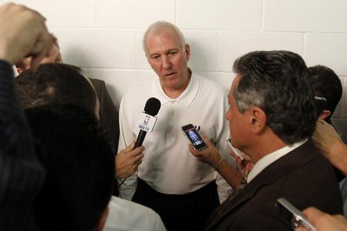 San Antonio Spurs head coach Gregg Popovich talks to reporters before an NBA basketball game against the Miami Heat, Thursday, Nov. 29, 2012, in Miami. ( AP Photo/Alan Diaz)