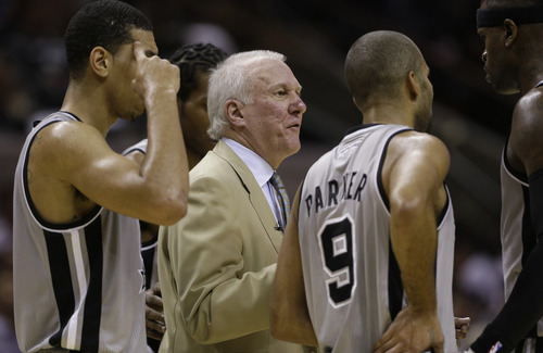 San Antonio Spurs coach Gregg Popovich, center, talks to his players during the third quarter of an NBA basketball game against the Oklahoma Thunder, Thursday, Nov. 1, 2012, in San Antonio. (AP Photo/Eric Gay)