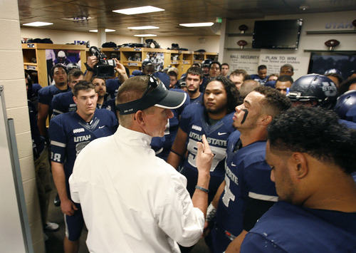 Scott Sommerdorf  |  The Salt Lake Tribune               Utah State Aggies head coach Gary Andersen gives his players encouragement in the locker room prior to taking the field to play the Idaho Vandals in Logan, Saturday, November 24, 2012.