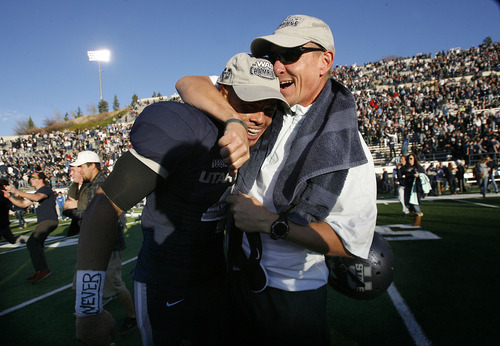 Scott Sommerdorf  |  The Salt Lake Tribune               Utah State Aggies head coach Gary Andersen hugs Utah State Aggies Senior WR Matt Austin (4) after the win over Idaho. Utah State defeated Idaho 45-9 in Logan, Saturday, November 24, 2012 to become champions of the WAC.
