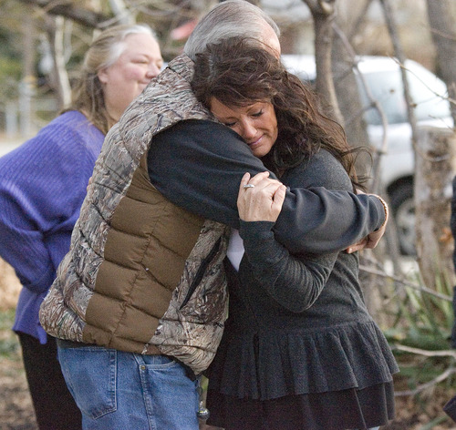 Paul Fraughton  | The Salt Lake Tribune On the second anniversary of Sherry Black's murder, Sherry's daughter, Heidi Miller, hugs her father, Earl. They were joined by family and friends to canvas the neighborhood around the Black home and post signs asking for information and offering a reward.