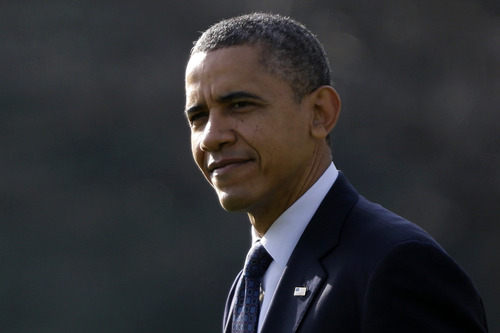 President Barack Obama walks on the South Lawn at the White House in Washington, Friday, Nov. 30, 2012, before boarding the Marine One helicopter enroute to Andrews Air Force Base, Md., then onto Hatfield, Pa. to speak at the Rodon Group manufacturing facility.  (AP Photo/Charles Dharapak)