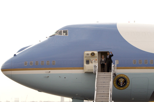President Barack Obama, accompanied by Rep. Allyson Schwartz, D-Pa., waves as they exit Air Force One upon their arrival at Philadelphia International Airport in Philadelphia, Friday Nov. 30, 2012. The president will tour and deliver remarks at The Rodon Group manufacturing facility in Hatfield, Pa.  (AP Photo/ Joseph Kaczmarek)