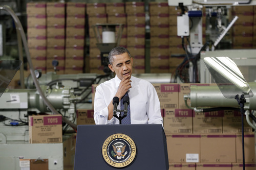 President Barack Obama pauses as he speaks at The Rodon Group manufacturing facility, Friday, Nov. 30, 2012, in Hatfield, Pa. Obama spoke at the toy company about how middle class Americans would see their taxes go up if Congress fails to act to extend the middle class tax cuts. (AP Photo/Matt Slocum)