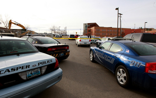 Law enforcement vehicles surround the campus after a reported homicide at Casper College on Friday morning, Nov. 30, 2012, in Casper, Wyo. At least one person was killed and another was wounded Friday in an attack at Casper College, a community college in central Wyoming. It happened around 9 a.m., said school spokesman Rich Fujita.  (AP Photo/Casper Star-Tribune, Alan Rogers) MANDATORY CREDIT  TRIB.COM
