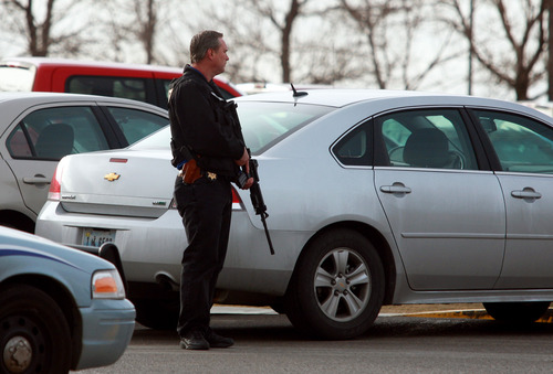 A Natrona County Sheriff's deputy stands watch at the scene of a reported homicide at Casper College on Friday morning, Nov. 30, 2012, in Casper, Wyo. At least one person was killed and another was wounded Friday in an attack at Casper College, a community college in central Wyoming. It happened around 9 a.m., said school spokesman Rich Fujita.  (AP Photo/Casper Star-Tribune, Alan Rogers) MANDATORY CREDIT TRIB.COM
