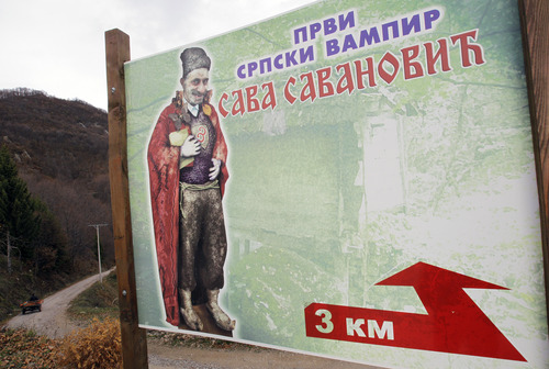 "In this Nov. 30, 2012 photo a billboard showing an impression of the legendary ghost Sava Savanovic. The poster reads ""First Serbian vampire"", near the village of Zarozje, near the Serbian town of Bajina Basta. Get your garlic, wooden crosses and stakes ready: a bloodsucking vampire is on the loose.  Or so say villagers in the tiny western Serbian hamlet of Zarozje, nestled between the lush green mountain slopes and spooky thick forests. Rumors that a legendary vampire ghost has returned are spreading panic throughout the town. An official warning telling villagers to put garlic in their pockets and place wooden crosses in each of their rooms, the tools that should keep away the vampires  did nothing but fuel the fear.  (AP Photo/Darko Vojinovic)"