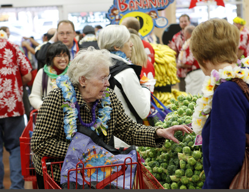 Al Hartmann  |  The Salt Lake Tribune Customers shop and get to know the new Trader Joe's during the opening of the new store at 634 East 400 South in Salt Lake City Friday November 30 at 8 a.m.
