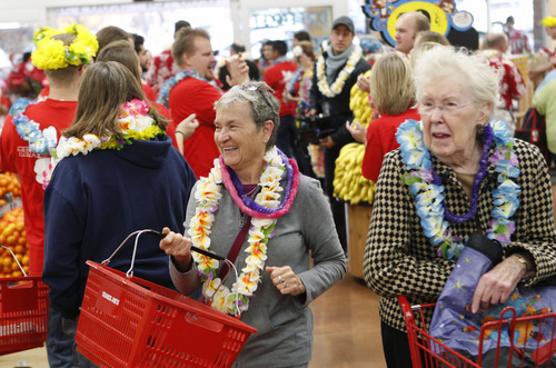 Al Hartmann  |  The Salt Lake Tribune Customers pour through the doors at Trader Joe's into a party atmosphere for the opening of the new store at 634 East 400 South in Salt Lake City Friday November 30 at 8 a.m.