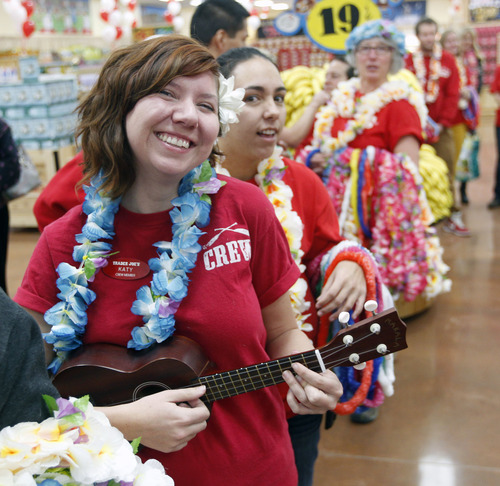 Al Hartmann  |  The Salt Lake Tribune Customers are greeted by Trader Joe's employees with a flower leis and a party atmosphere as they enter the new store for at 634 East 400 South in Salt Lake City Friday November 30 at 8 a.m.