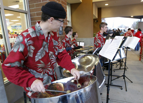 Al Hartmann  |  The Salt Lake Tribune Steel drum band plays Carribean music for the opening of Trader Joe's at 634 East 400 South in Salt Lake City Friday November 30.