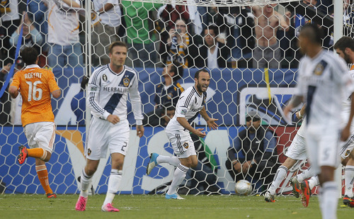 Los Angeles Galaxy's Landon Donovan, center, celebrates his goal during the second half of the MLS Cup championship soccer match against the Houston Dynamo in Carson, Calif., Saturday, Dec. 1, 2012. (AP Photo/Jae C. Hong)