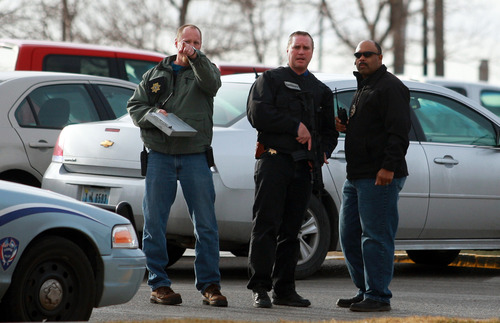 Law enforcement officers talk at the scene of a reported homicide at Casper College on Friday morning, Nov. 30, 2012, in Casper, Wyo. At least one person was killed and another was wounded Friday in an attack at Casper College, a community college in central Wyoming. It happened around 9 a.m., said school spokesman Rich Fujita.  (AP Photo/Casper Star-Tribune, Alan Rogers) MANDATORY CREDIT  TRIB.COM