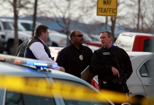 Law enforcement officers talk as they investigate a homicide at Casper College on Friday morning, Nov. 30, 2012, in Casper, Wyo. At least one person was killed and another was wounded Friday in an attack at Casper College, a community college in central Wyoming. It happened around 9 a.m., said school spokesman Rich Fujita.  (AP Photo/Casper Star-Tribune, Alan Rogers)  MANDATORY CREDIT TRIB.COM