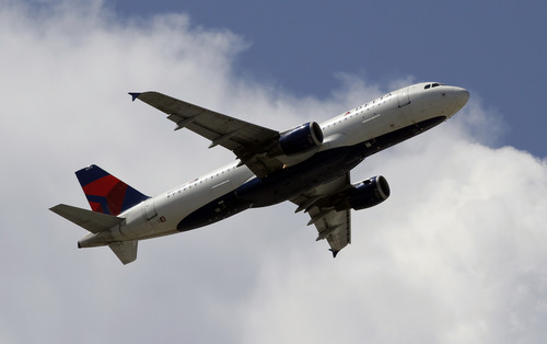 (AP Photo/Alan Diaz) This Monday, Aug. 20, 2012, photo, shows a Delta Airlines aircraft taking off at Miami International Airport in Miami.