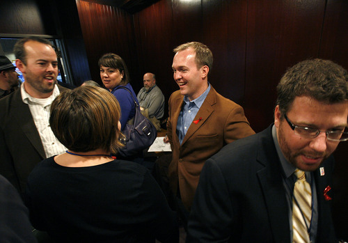 Scott Sommerdorf  |  The Salt Lake Tribune               Salt Lake County Mayor-elect Ben McAdams holds court while waiting for Democratic delegates to select his replacement as the state senator representing District 2 in downtown Salt Lake City.