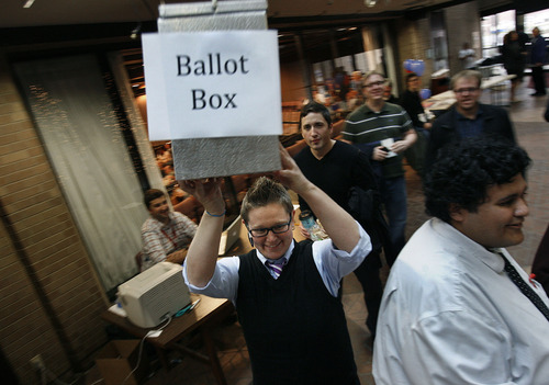 Scott Sommerdorf  |  The Salt Lake Tribune               State Democratic Party Executive Director Lauren Littlefield sweeps away the ballot box for a final count in the runoff between Jim Dabakis and Peter Corroon for the state Senate District 2 seat. Dabakis won the election 67-61.