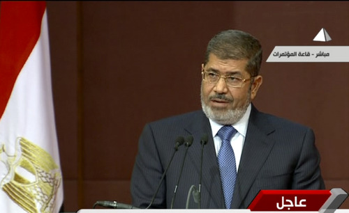 In this image made from a live broadcast on Egyptian State Television, Egyptian President Mohammed Morsi speaks to the constituent assembly in Cairo, Egypt, Saturday, Dec. 1, 2012. Morsi spoke as more than 100,000 Islamists waved Egyptian flags and hoisted portraits of Morsi in rallies nationwide Saturday to support his efforts to rush through a new draft constitution despite widespread opposition by secular activists and some in the judiciary.(AP Photo/Egyptian State Television)