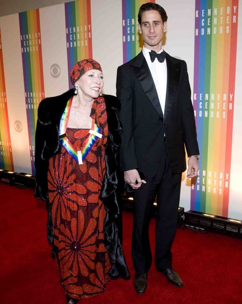 Kennedy Center Honoree Natalia Makarova arrives with her son, Andrei Karkar, at the Kennedy Center for the Performing Arts for the 2012 Kennedy Center Honors Performance and Gala Sunday, Dec. 2, 2012 at the State Department in Washington. (AP Photo/Kevin Wolf)