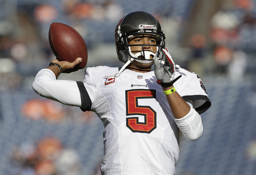 Tampa Bay Buccaneers quarterback Josh Freeman (5) throws a pass as he warms up before an NFL football game between the Denver Broncos and the Tampa Bay Buccaneers Sunday, Dec. 2, 2012, in Denver. (AP Photo/Joe Mahoney)