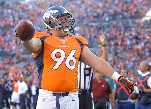 Denver Broncos defensive tackle Mitch Unrein (96) reacts after scoring a touchdown against the Tampa Bay Buccaneers in the first quarter of an NFL football game, Sunday, Dec. 2, 2012, in Denver. (AP Photo/Jack Dempsey)