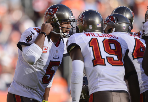 Tampa Bay Buccaneers quarterback Josh Freeman (5) calls a play in the huddle during the first quarter  of an NFL football game against the Denver Broncos on Sunday, Dec. 2, 2012, in Denver. (AP Photo/Jack Dempsey)
