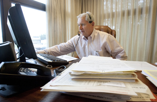 Steve Griffin | The Salt Lake Tribune   Joseph Hillam, a gastroenterologist, dictates case notes into his computer in his Brigham City, Utah officeThursday October 25, 2012. Hillam has an office in a multi-unit building in Brigham City that he shares with about eight other medical providers. They all agreed to have the building hook into UTOPIA and were able to split the hefty connection fee among them. Hillam loves the internet speed he gets, but says the bundled phone service is cumbersome when it comes to sending and receiving faxes.