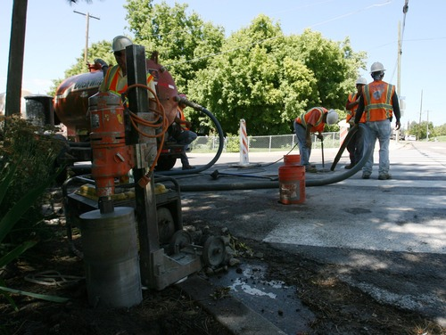 Steve Griffin  |  The Salt Lake Tribune   A work crew for Utopia, works near 2000 north Main Street  in Centerville,  Utah Monday, August 22, 2011 as they prepare to lay conduit under the road. The conduit will house fiber optic cables.