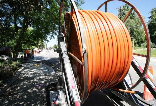 Steve Griffin  |  The Salt Lake Tribune   A giant roll of orange conduit is at the ready as crews for Utopia, far left, use a drill to make a path for the conduit in Centerville,  Utah Monday, August 22, 2011. The conduit will house fiber optic cables.