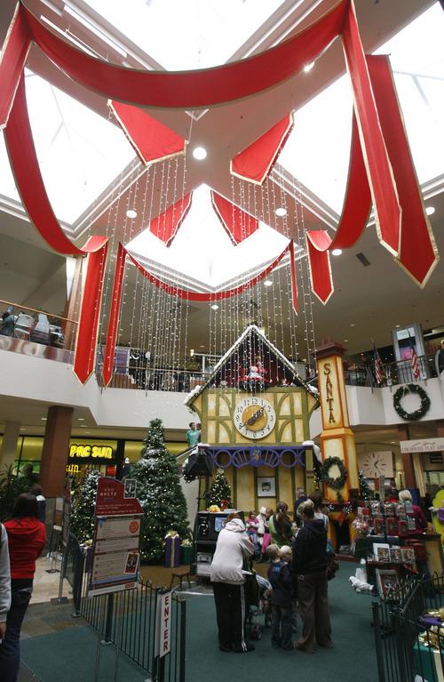 Rick Egan  | The Salt Lake Tribune   Kids line up to have their photos taken with Santa, at Layton Hills mall, Friday, November 23, 2012.