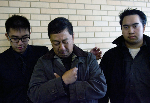 Kim Raff  |  The Salt Lake Tribune Nhuan Phan, center, father of David Phan, is comforted by David's older brother Don, left, as the family speaks Sunday for the first time about the 14-year-old who took his own life near Bennion Junior High School. Viet Dinh looks on during a news conference outside the Kearns Public Library.
