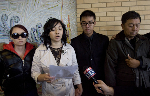 Kim Raff  |  The Salt Lake Tribune Thanh-Tung Than-Trong, spokesperson for the family of David Phan, makes a statement Sunday during a news conference about David's suicide outside Bennion Junior High School. The family believes David was relentlessly bullied at school even as the school says it was unaware of such problems. David's brother Don (second from right) and father Nhuan Phan (right) stood by as Than-Trong read a statement.
