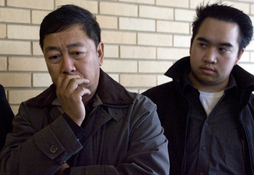 Kim Raff  |  The Salt Lake Tribune Nhuan Phan, left, father of David Phan, becomes emotional as Viet Dinh looks on during a family news conference on Sunday outside the Kearns Public Library. The family said 14-year-old David, who took his own life Thursday, shielded them from the torment he was experiencing, including bullying at school.