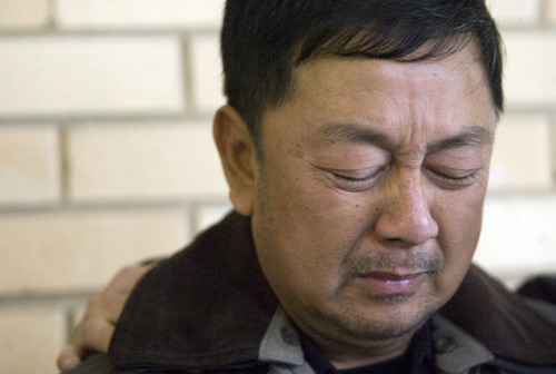 Kim Raff  |  The Salt Lake Tribune Nhuan Phan, father of David Phan, becomes emotional as a spokesperson for the family makes a statement about David's suicide outside Bennion Junior High School in Taylorsville. The family spoke publicly for the first time Sunday, saying 14-year-old David shielded them from the bullying and problems he was facing at school. The school says it was not alerted to the bullying.