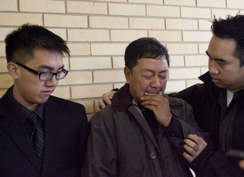 Kim Raff  |  The Salt Lake Tribune Don Phan, left, brother of David Q. Phan, and family member Viet Dihn comfort Nhuan Phan, father of David, as he becomes emotional as a spokesperson for the family makes a statement about David Q. Phan, the 14-year-old who committed suicide outside of the Bennion Junior High School in Taylorsville, outside the Kearns Public Library in Kearns on December 2, 2012.  The family believes David was relentlessly bullied at school even as the school denies this accusation.