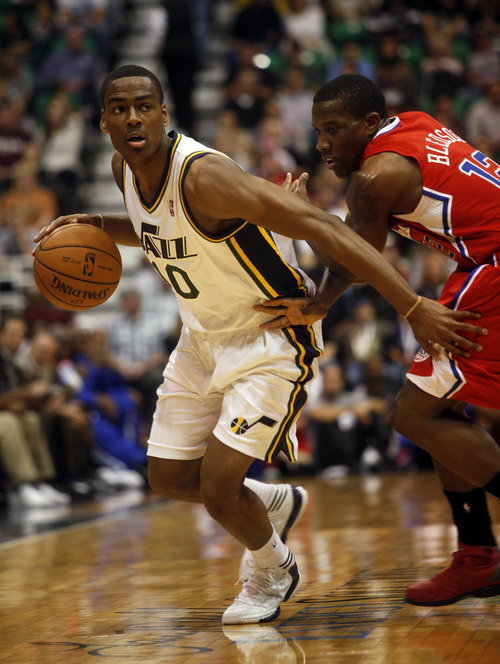 Ashley Detrick     The Salt Lake Tribune Alec Burks looks for a pass in the first half of the game against the Clippers on Saturday, Oct. 20, 2012 at Energy Solutions in Salt Lake City.