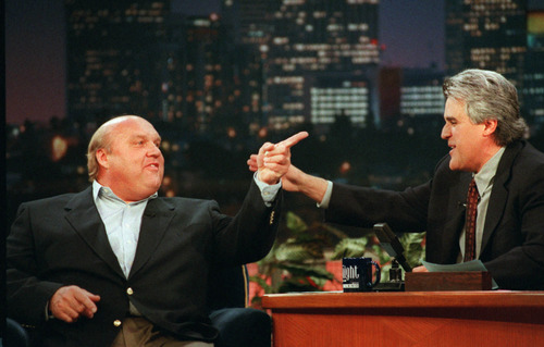 "University of Utah basketball coach Rick Majerus jokes with ""Tonight Show"" host Jay Leno during taping Friday April 3, 1998 in Burbank, Calif. Majerus' Utes lost to the Kentucky Wildcats in the NCAA Finals. (AP Photo/Margaret Norton)"