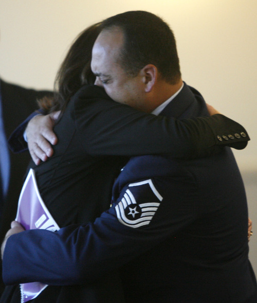Rick Egan  | The Salt Lake Tribune   Tim Molder, father of Blake Molder hugs a loved one outside the courtroom Monday, December 3, 2012.  Molder was sentenced to 1-15 years in prison for causing the crash that killed Cottonwood High School assistant football coach Michael Gallegos in June.