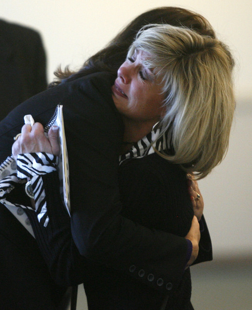 Rick Egan  | The Salt Lake Tribune   Tammy Molder, mother of Blake Molder hugs a loved one outside the courtroom Monday, December 3, 2012.  Blake Molder was sentenced to 1-15 years in prison for causing the crash that killed Cottonwood High School assistant football coach Michael Gallegos in June.