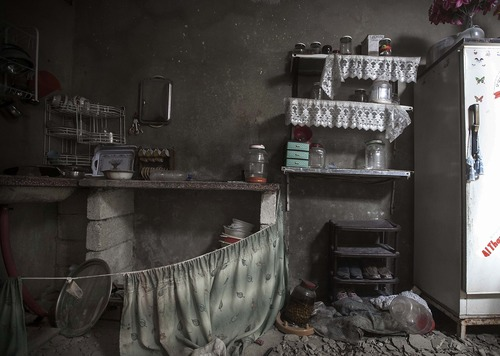 This Sunday, Dec. 2, 2012 photo, shows a damaged kitchen inside a residential house due to heavy fighting between Free Syrian Army fighters and government forces in Aleppo, Syria. (AP Photo/Narciso Contreras)