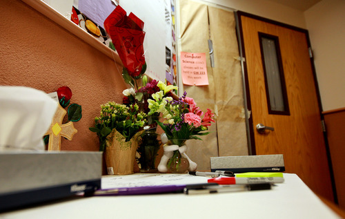 An impromptu memorial to Casper College instructors Jim Krumm and Heidi Arnold was set up Monday, Dec. 3, 2012 outside room 325 of the World Physical Science Center on the campus in Casper, Wyo. Chris Krumm, 25, killed Heidi Arnold outside the home she and Jim Krumm shared on Friday morning before killing his father and himself in the classroom. (AP Photo/Star-Tribune, Alan Rogers)