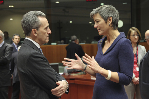 Italian Finance Minister Vittorio Grilli, left, talks with Danish Finance Minister Margrethe Vestager, during the EU finance ministers meeting, at the European Council building in Brussels, Tuesday, Dec. 4, 2012. European Union finance ministers will seek to agree Tuesday to the principles of a eurozone banking supervisor, EU diplomats said. Earlier this year, the 27 member states pledged to reach the outlines of an agreement by the end of 2012, allowing the supervisor to come into force during the course of the following year. (AP Photo/Yves Logghe)