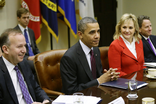 President Barack Obama, flanked by National Governors Association (NGA) Chairman, Delaware Gov. Jack Martell, and NGA Vice Chair, Oklahoma Gov. Mary Fallin, meets with the NGA executive committee regarding the fiscal cliff, Tuesday, Dec. 4, 2012, in the Roosevelt Room at the White House in Washington. Treasury Secretary Tim Geithner is at right. (AP Photo/Charles Dharapak)