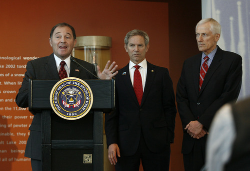 Scott Sommerdorf  |  The Salt Lake Tribune               Utah Gov. Gary Herbert (left), Salt Lake City Mayor Ralph Becker (center) and Lt. Gov. Greg Bell (right) announced they enthusiastically back a recommendation that Salt Lake City bid to host the 2026 Winter Olympics. The leaders held a news conference Monday at the Olympic Cauldron Park & Visitor Center Gallery, at Rice-Eccles Stadium.