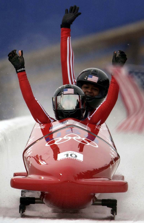 USA gold medalists Jill Bakken (front) and Vonetta Flowers celebrate their track record first run. Women's Bobsled, Tuesday evening at the Utah Olympic Park, 2002 Olympic Winter Games. Photo by Trent Nelson 02.19.2002, 4:57:57 PM