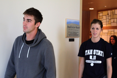 Rick Egan  | The Salt Lake Tribune   John Berger and his sister Lauren Berger leave the meditation room, after making a statement about their brother, USU basketball player Danny Berger at Intermountain Medical Center in Murray, Wednesday, December 5, 2012. Danny Berger collapsed during basketball practice Tuesday in Logan.